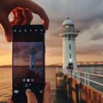 Urlauber fotografiert Leuchtturm